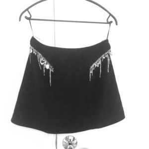 Skirt with attached tasseled jewelry